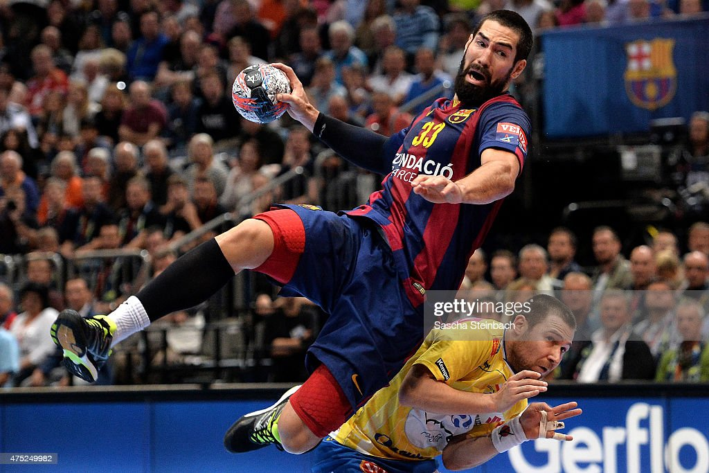 <a gi-track='captionPersonalityLinkClicked' href=/galleries/search?phrase=Nikola+Karabatic&family=editorial&specificpeople=620415 ng-click='$event.stopPropagation()'>Nikola Karabatic</a> of Barcelona throws the ball during the 'VELUX EHF FINAL4' semi final match FC Barcelona and KS Vive Tauron Kielce at Lanxess Arena on May 30, 2015 in Cologne, Germany.