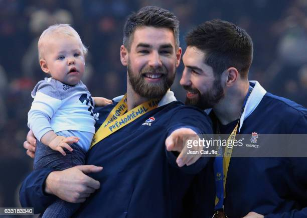 Nikola Karabatic of France and his brother Luka Karabatic holding Nikola's son Alek Karabatic celebrate the victory following the 25th IHF Men's...
