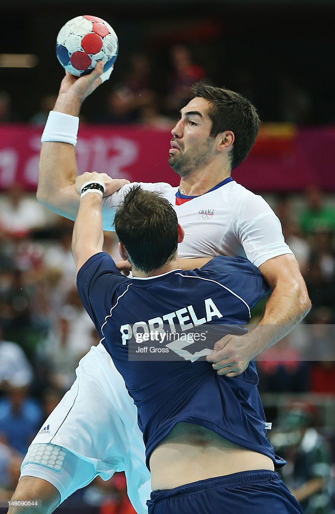 <a gi-track='captionPersonalityLinkClicked' href=/galleries/search?phrase=Nikola+Karabatic&family=editorial&specificpeople=620415 ng-click='$event.stopPropagation()'>Nikola Karabatic</a> of France battles with Pablo Sebastian Portela of Argentina during the Men's Handball Preliminary match between Argentina and France on Day 4 of the London 2012 Olympic Games at The Copper Box on July 31, 2012 in London, England.