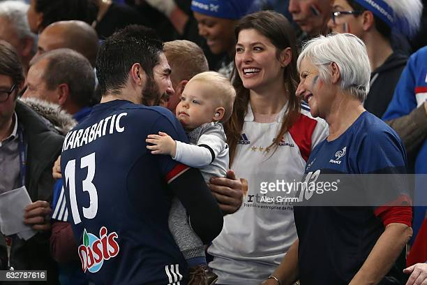 Nikola Karabatic of France celebrate with his partner Geraldine Pillet and their son Alek after the 25th IHF Men's World Championship 2017 Semi Final...