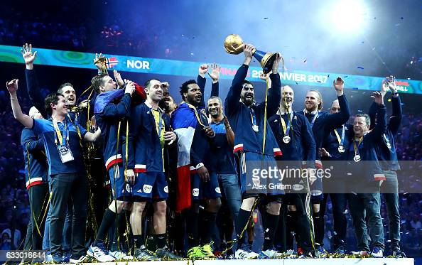 Nikola Karabatic of France celebrates victory with the trophy and team mates after the 25th IHF Men's World Championship 2017 Final between France...