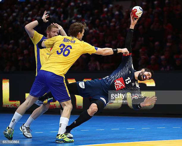 Nikola Karabatic of France challenges Jesper Neilsen of Sweden during the 25th IHF Men's World Championship 2017 Quarter Final match between France...