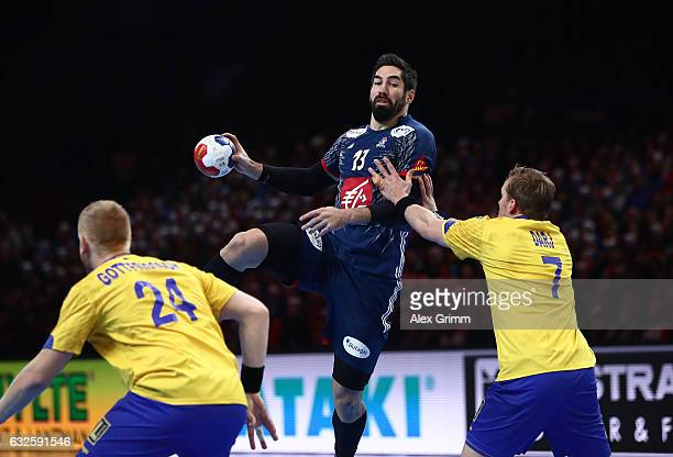 Nikola Karabatic of France challenges Max Darj of Sweden during the 25th IHF Men's World Championship 2017 Quarter Final match between France and...