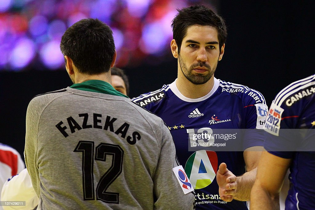 <a gi-track='captionPersonalityLinkClicked' href=/galleries/search?phrase=Nikola+Karabatic&family=editorial&specificpeople=620415 ng-click='$event.stopPropagation()'>Nikola Karabatic</a> of France (R) congratulates Nador Fazekas of Hungary (L) after losing 23-26 the Men's European Handball Championship group C match between France and Hungary at Spens Arena on January 20, 2012 in Novi Sad, Serbia.