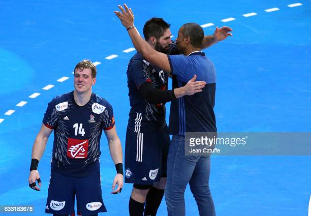 Nikola Karabatic of France greets coach of France Didier Dinart while Kevin Mahe looks on following the 25th IHF Men's World Championship 2017 Final...
