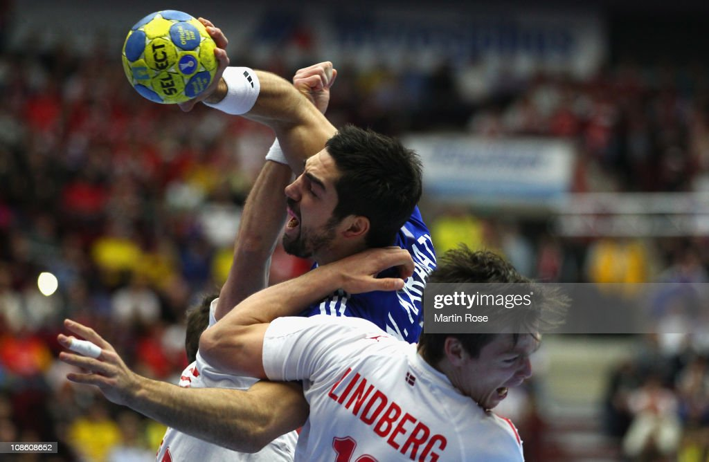 Nikola Karabatic (L) of France is challenged by Hans Lindberg (R) of Denmark during the Men's Handball World Championship final match between France and Danmark at Malmo Arena on January 30, 2011 in Malmo, Sweden.