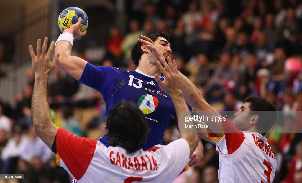 <a gi-track='captionPersonalityLinkClicked' href=/galleries/search?phrase=Nikola+Karabatic&family=editorial&specificpeople=620415 ng-click='$event.stopPropagation()'>Nikola Karabatic</a> (C) of France is challenged by Ruben Garabaya (L) and Eduardo Gurbindo (R) of Spain during the Men's Handball World Championship Group A match between France and Spain at Kristianstad Arena on January 20, 2011 in Kristianstad, Sweden.