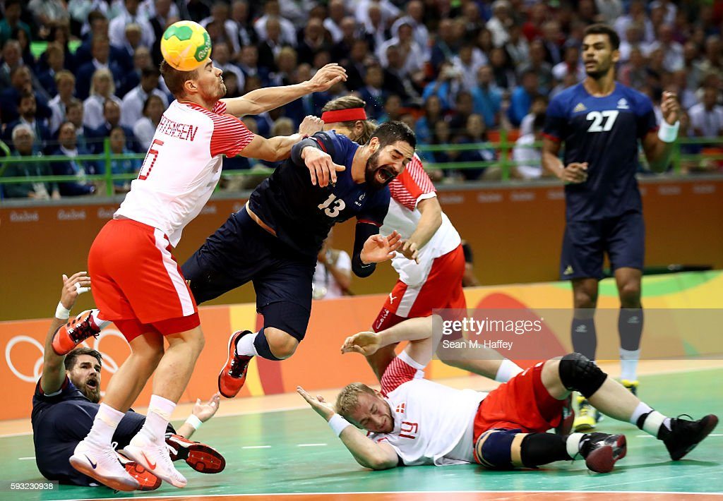 Nikola Karabatic of France loses the ball against Casper Mortensen of Denmark during the first half in the Men's Gold Medal Match between Denmark and...