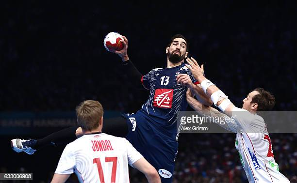 Nikola Karabatic of France shoots while Christian O'Sullivan of Norway attempts to block during the 25th IHF Men's World Championship 2017 Final...