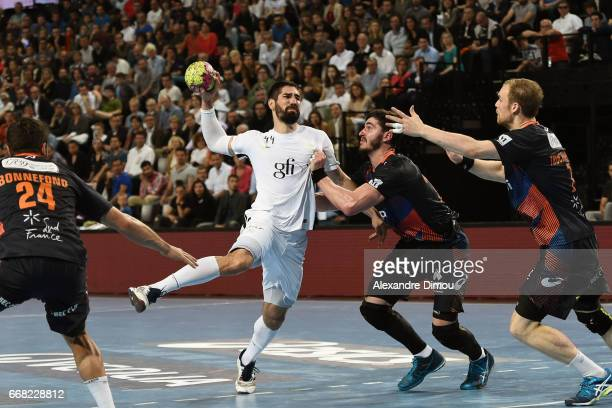 Nikola Karabatic of Paris and Jonas Truchanovicius and Ludovic Fabregas of Montpellier during the Starligue Lidl match between Montpellier and Paris...