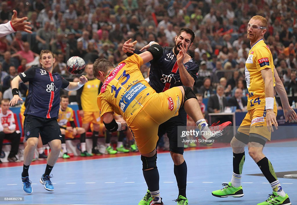 <a gi-track='captionPersonalityLinkClicked' href=/galleries/search?phrase=Nikola+Karabatic&family=editorial&specificpeople=620415 ng-click='$event.stopPropagation()'>Nikola Karabatic</a> of Paris (2nR) is attacked by Julen Ahuinagalde Akizu of Kielce (#13) during the first semi-final of the EHF Final4 between VS Tauron Kielce and Paris Saint-Germain on May 28, 2016 in Cologne, Germany.