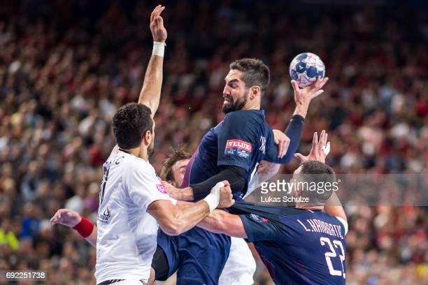 Nikola Karabatic of Paris is attacked by the defense of Vardar during the VELUX EHF FINAL4 Final match between Paris SaintGermain Handball and HC...