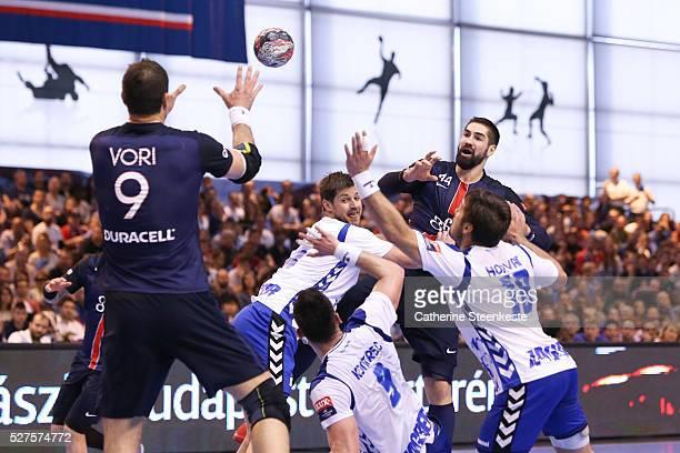 Nikola Karabatic of Paris Saint Germain is passing the ball to Igor Vori of Paris Saint Germain against Tonci Valcic Tin Kontrec and Zlatko Horvat of...