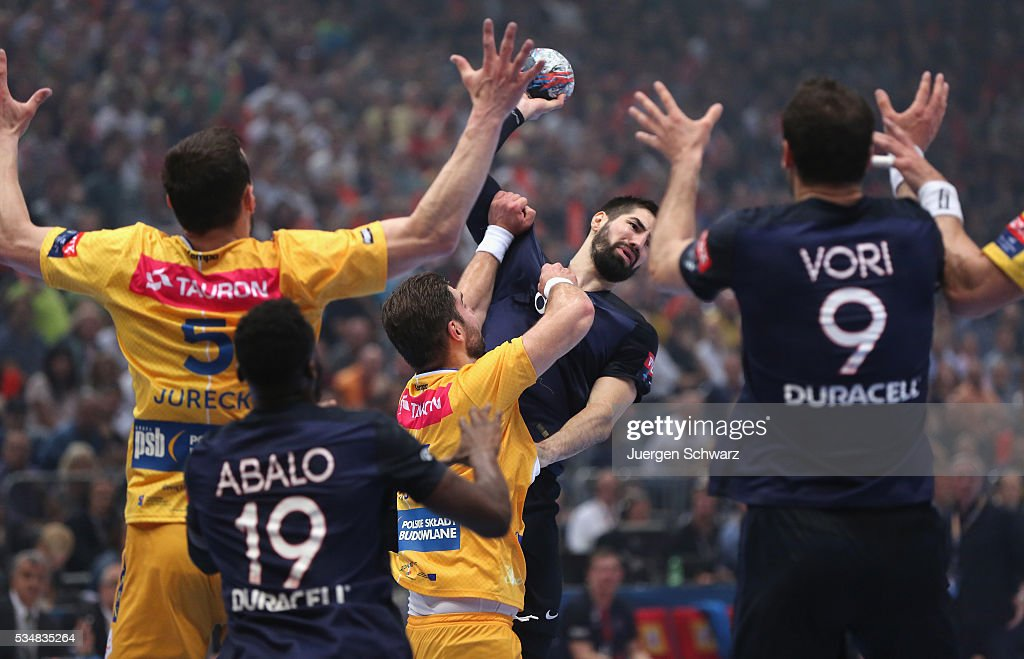<a gi-track='captionPersonalityLinkClicked' href=/galleries/search?phrase=Nikola+Karabatic&family=editorial&specificpeople=620415 ng-click='$event.stopPropagation()'>Nikola Karabatic</a> of Paris (C) throws the ball during the first semi-final of the EHF Final4 between VS Tauron Kielce and Paris Saint-Germain on May 28, 2016 in Cologne, Germany.