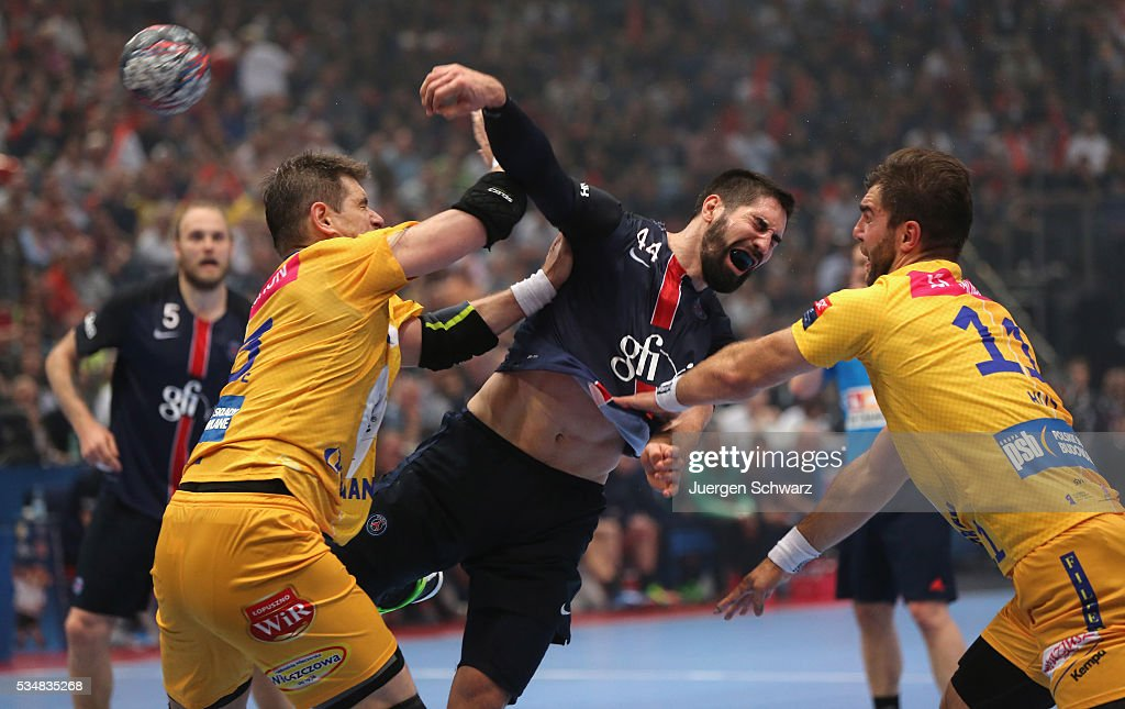 <a gi-track='captionPersonalityLinkClicked' href=/galleries/search?phrase=Nikola+Karabatic&family=editorial&specificpeople=620415 ng-click='$event.stopPropagation()'>Nikola Karabatic</a> of Paris (C) throws the ball near Mateusz Kus of Kielce (R) and Michal Jurecki during the first semi-final of the EHF Final4 between VS Tauron Kielce and Paris Saint-Germain on May 28, 2016 in Cologne, Germany.