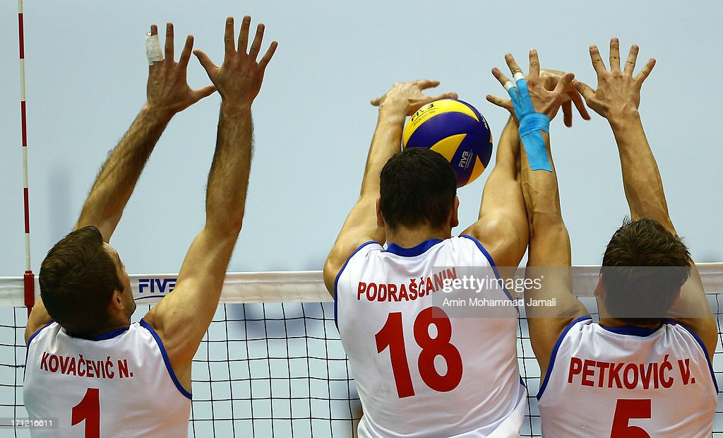 Nikola Kovacevic and Marko Podrascanin and Vlado Petkovic of Serbia in action during the Volleyball World League match between Iran and Serbia on...