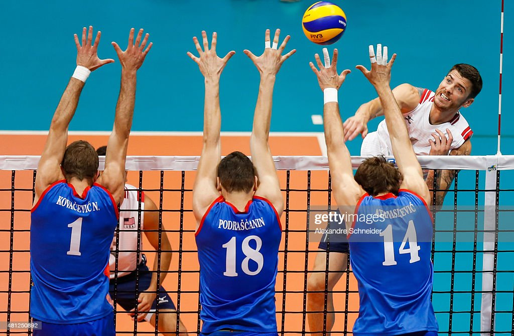 Nikola Kovacevic Marko Podrascanin and Aleksandar Atanasijevic of Serbia block the ball during the match between United States and Serbia at...