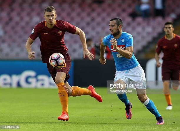 Nikola Maksimovic of Napoli competes for the ball with Edin Dzeko of Roma during the Serie A match between SSC Napoli and AS Roma at Stadio San Paolo...