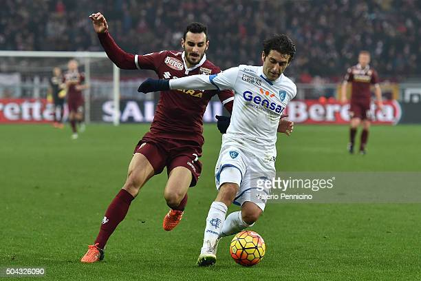 Nikola Maksimovic of Torino FC competes with Daniele Croce of Empoli FC during the Serie A match between Torino FC and Empoli FC at Stadio Olimpico...