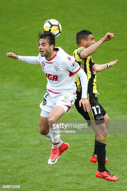 Nikola Mileusnic of Adelaide United and Ali Abbas of the Phoenix compete for a header during the round one ALeague match between Wellington Phoenix...