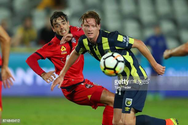 Nikola Mileusnic of Adelaide United contests the ball with Kye Rowles of the Mariners during the round seven ALeague match between the Central Coast...