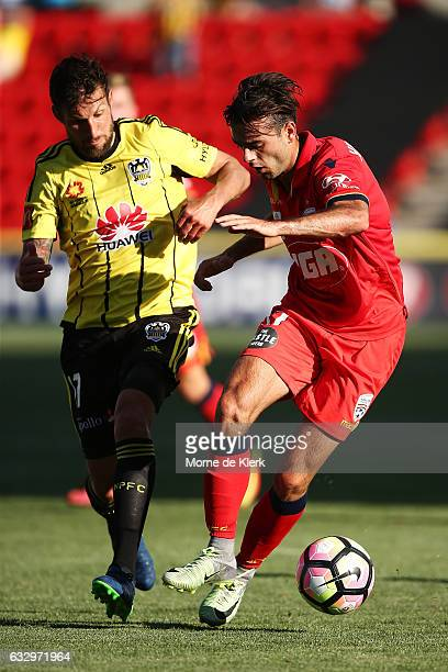 Nikola Mileusnic of Adelaide United gets away from Vince Lia of Wellington Phoenix during the round 17 ALeague match between Adelaide United and the...