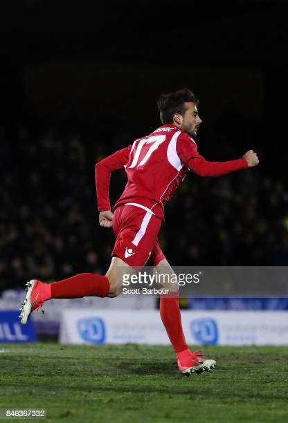 Nikola Mileusnic of Adelaide United is congratulated by his teammates after scoring his second goal during the FFA Cup Quarter Final match between...