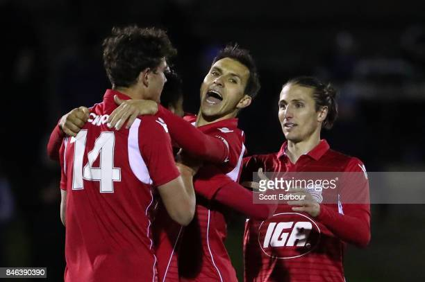 Nikola Mileusnic of Adelaide United is congratulated by his teammates after scoring his third goal during the FFA Cup Quarter Final match between...