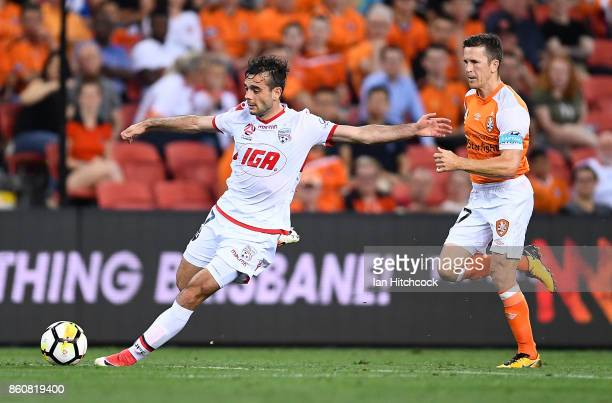 Nikola Mileusnic of Adelaide United makes a run past Matt McKay of the Roar during the round two ALeague match between the Brisbane Roar and Adelaide...