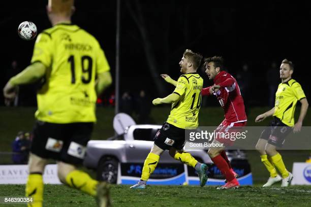 Nikola Mileusnic of Adelaide United scores his third goal during the FFA Cup Quarter Final match between Heidelberg United FC and Adelaide United at...