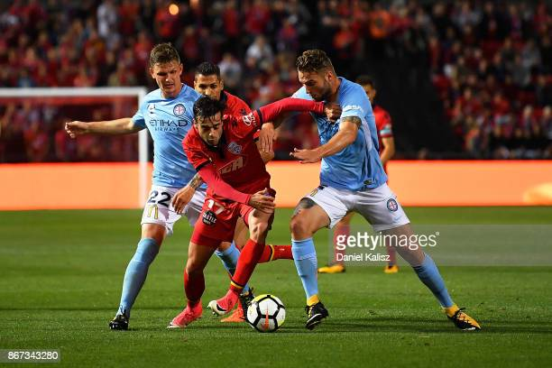 Nikola Mileusnic of United competes for the ball during the round four ALeague match between Adelaide United and Melbourne City FC at Coopers Stadium...