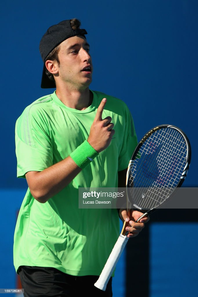 Nikola Milojevic of Serbia celebrates in his first round match against Jurence Zosimo Mendoza of Philippines during the 2013 Australian Open Junior Championships at Melbourne Park on January 19, 2013 in Melbourne, Australia.