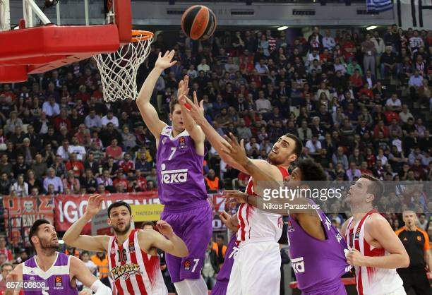 Nikola Milutinov #11 of Olympiacos Piraeus competes with Luka Doncic #7 of Real Madrid during the 2016/2017 Turkish Airlines EuroLeague Regular...