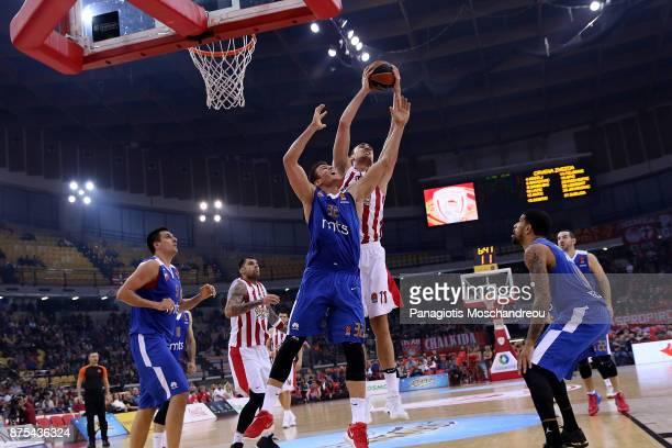 Nikola Milutinov #11 of Olympiacos Piraeus competes with Nikola Jovanovic #32 of Crvena Zvezda mts Belgrade during the 2017/2018 Turkish Airlines...