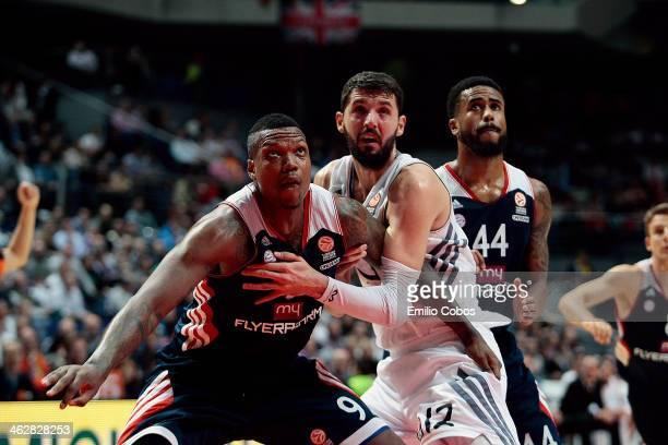 Nikola Mirotic #12 of Real Madrid competes with Deon Thompson #9 of FC Bayern Munich during the 20132014 Turkish Airlines Euroleague Top 16 Date 3...