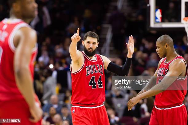 Nikola Mirotic celebrates with Cristiano Felicio of the Chicago Bulls after Mirotic scored during the second half against the Cleveland Cavaliers at...