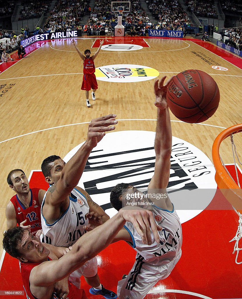 Nikola Mirotic #12 of Real Madrid grabs a rebound aginst <a gi-track='captionPersonalityLinkClicked' href=/galleries/search?phrase=Sasha+Kaun&family=editorial&specificpeople=802084 ng-click='$event.stopPropagation()'>Sasha Kaun</a> #24 of CSKA Moscow during the Turkish Airlines Euroleague Top 16 game at Palacio de los Deportes on January 31, 2013 in Madrid, Spain.