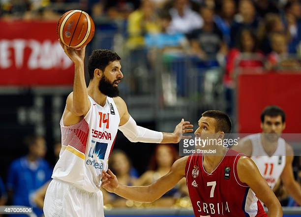 Nikola Mirotic of Spain looks to pass the ball against Bogdan Bogdanovic of Serbia during the FIBA EuroBasket 2015 Group B basketball match between...