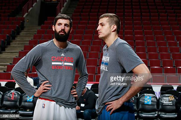 Nikola Mirotic of the Chicago Bulls and Nemanja Bjelica of the Minnesota Timberwolves talk before the game on November 7 2015 at the United Center in...
