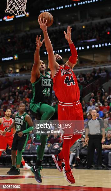Nikola Mirotic of the Chicago Bulls drives past Al Horford of the Boston Celtics at the United Center on December 11 2017 in Chicago Illinois NOTE TO...