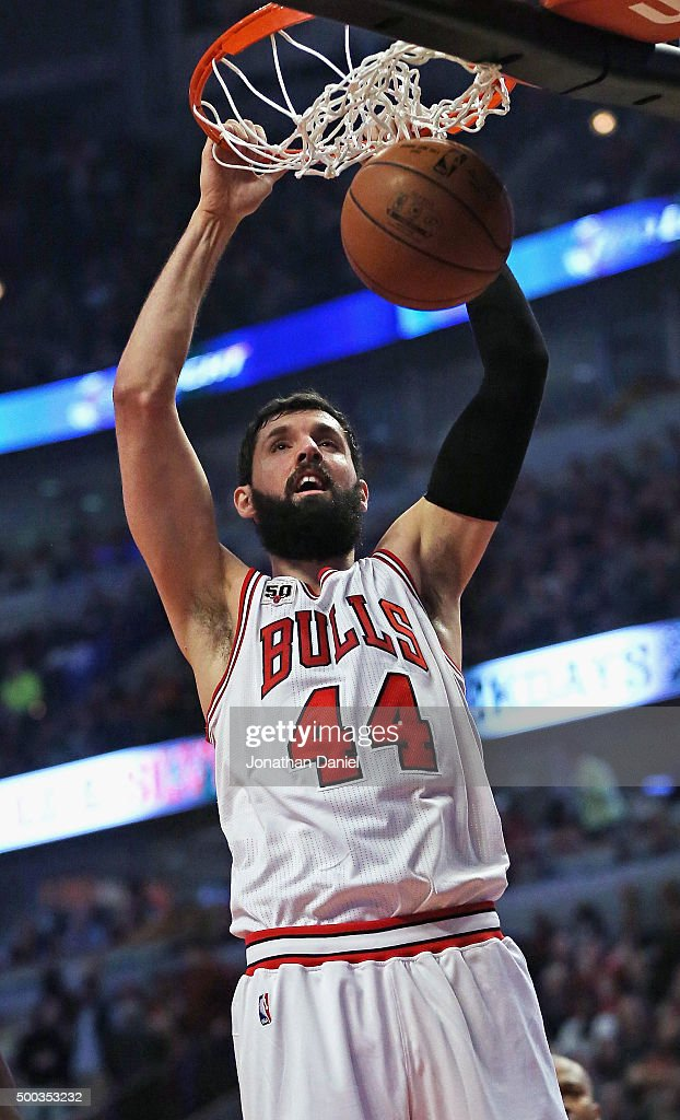 Nikola Mirotic #44 of the Chicago Bulls dunks against the Phoenix Suns at the United Center on December 7, 2015 in Chicago, Illinois.