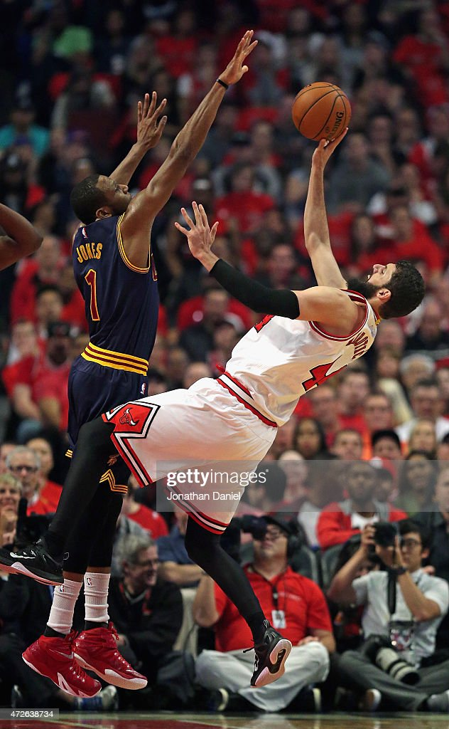 Nikola Mirotic #44 of the Chicago Bulls gets off a shot against James Jones #1 of the Cleveland Cavaliers in Game Three of the Eastern Conference Semifinals of the 2015 NBA Playoffs at the United Center on May 8, 2015 in Chicago, Illinois.