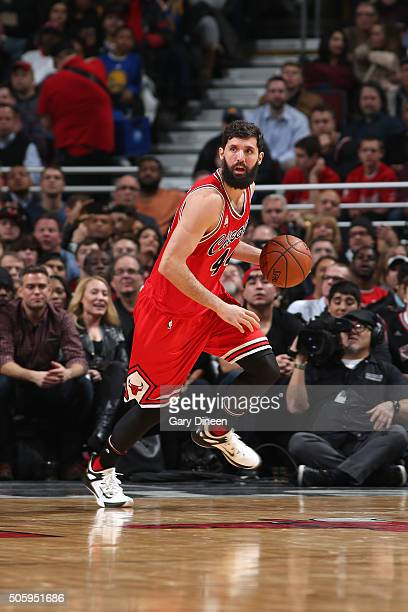 Nikola Mirotic of the Chicago Bulls handles the ball during the game against the Golden State Warriors on January 20 2016 at the United Center in...