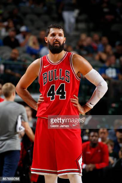Nikola Mirotic of the Chicago Bulls looks on during the game against the Dallas Mavericks on October 4 2017 at the American Airlines Center in Dallas...