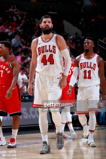 Nikola Mirotic of the Chicago Bulls looks on during the game against the Toronto Raptors on October 13 2017 at the United Center in Chicago Illinois...