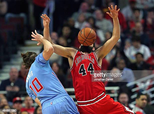 Nikola Mirotic of the Chicago Bulls looses the ball after being fouled by Spencer Hawes of the Los Angeles Clippers at the United Center on March 1...