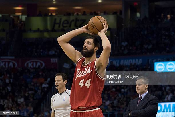 Nikola Mirotic of the Chicago Bulls passes the ball against the Oklahoma City Thunder during the first quarter of a NBA game at the Chesapeake Energy...