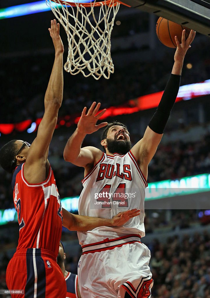 Nikola Mirotic #44 of the Chicago Bulls puts up a shot against Otto Porter Jr. #22 of the Washington Wizards on his way to a game-high 23 points at the United Center on March 3, 2015 in Chicago, Illinois. The Bulls defeated the Wizards 97-92.