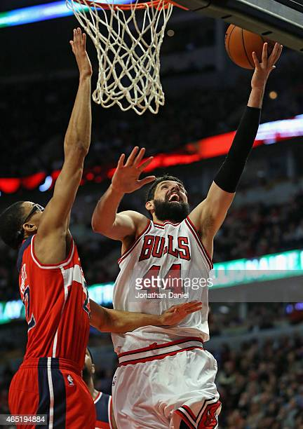 Nikola Mirotic of the Chicago Bulls puts up a shot against Otto Porter Jr #22 of the Washington Wizards on his way to a gamehigh 23 points at the...