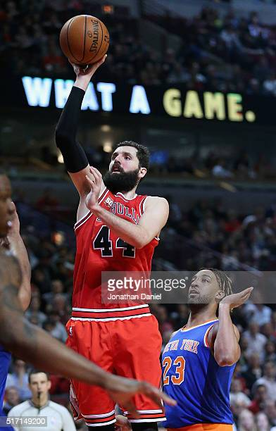 Nikola Mirotic of the Chicago Bulls puts up a shot in front of Derrick Williams of the New York Knicks on hi s way to a game and career high 35...